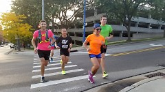 Runners run back up Fulton to Lafayette in the Hills & Stairs group.