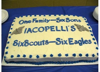 Cake celebrating six Iacobelli Eagle Scouts