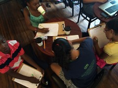 Attendees of the CYC's Summer Safari program direct their creative thoughts to the page at Sparrows Coffee Tea & Newstand