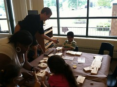 Ben Ruehrdanz help the kids build birdhouses.