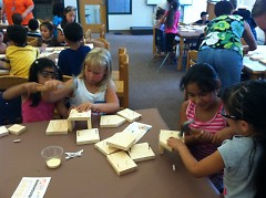 Kindergartners team up with second graders to build the birdhouses.