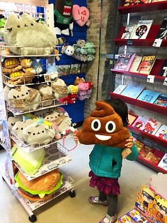 The Vault also carries a variety of toys, apparel and accessories, such as these Pusheen and emoji plushies.