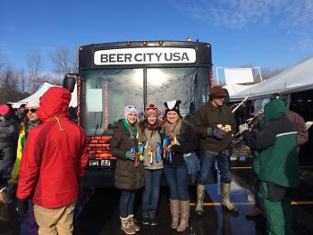 McKenna Jaekel, Ashlyn Jaekel and Megan Stone show Beer City pride with Perrin's bus.
