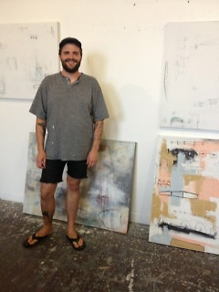 The artist by a few of his works in his warehouse studio