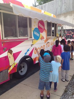 Cook Arts Center students line up outside the food truck with excitement