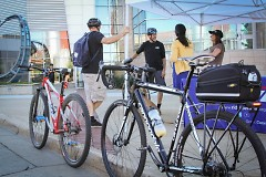 Bike to Work Day participants grabbing snacks and giveaway items at Rapid Central Station last year.