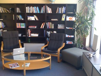 The newsroom is outfitted with comfy chairs, tea, and many resources to help you hone your reporting skills.
