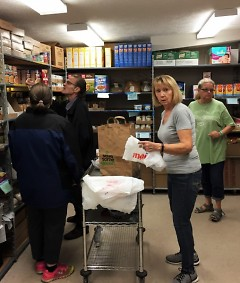 Clients and volunteers work together to combat hunger at Northwest Food Pantry.