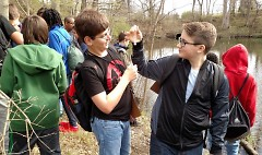 Seventh-grade students from Pinewood Middle School explore the water quality of Buck Creek