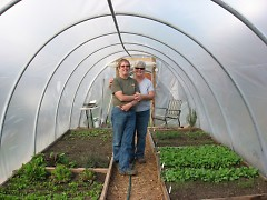Lane and Sanwald in one of their hoophouses at Brickyard Farms.