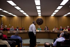 Concerned citizen addresses city commissioners on December 2 at City Hall