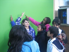 The GAAH Press Club in front of the green screen.