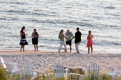 Guests taking a beach stroll at the first Summer Soiree.