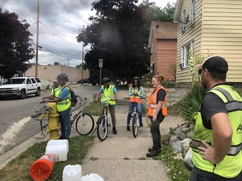 Friends of Grand Rapids Parks' Green Team, watering newly planted trees around Grand Rapids.