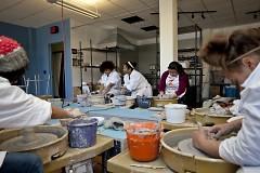 Ceramics students throwing pots.