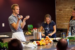 Chef Chris McKellar talking to the class about how to break down a chicken