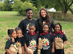 Students from Coit Creative Arts Academy and Kids Food Basket participants with Executive Director, Bridget Clark Whitney