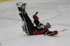 Former Griffin captain Garnet Exelby experiences the challenges of sled hockey during last year's Griffins-Sled Wings game