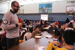 Ben Oliver, AmeriCorps ESL teacher, speaks with a family in the Schools of Hope Family Literacy Program.