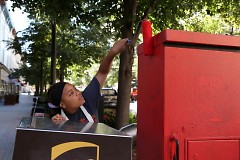 Jimia Williams, 17, prepares a utility box for a mural of Frida Kahlo at Monroe Center and Ionia