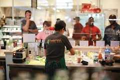Customers at the Malamiah Juice Bar in the Downtown Market