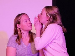 Amy blowing in Kristin's eye during a performance
