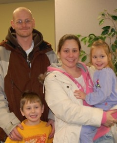A happy family served by the Kent County Tax Credit Coalition.