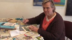 Debra Dieppa works on a collage.
