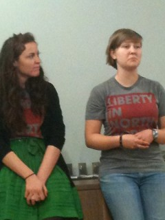 Two of the Nomads speak to the group.