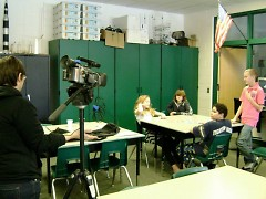CMC's Lynn McKeown, pictured with a group of students learning video and story collecting, which is part of the May 2 event.