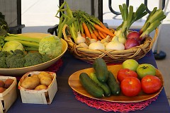 Locally grown food sits on a vendors table at the South East Area Farmer's Market