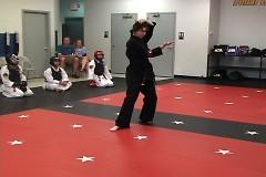 Black Belt Student Sarah Black perfoming her form.