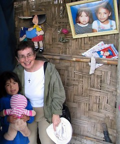 Sister Mary Navarre with one of the local Chimbote children.