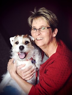 Mary Ullmer, with her Jack Russell terrier Stuart. Ullmer now is editor of a new magazine called Dogs Unleashed.