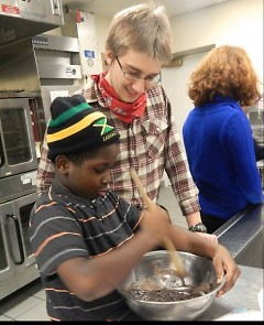 Calvin College students mentor neighborhood youth in Oakdale Neighbors' baking class.