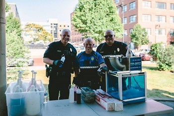 Community Officers Brian Grooms, Mike Sowle, and Rich Atha served snow-cones at National Night Out 2018