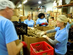 Companies both local and national volunteer at the Food Bank. These Nestle employees sorted potatoes in early October.