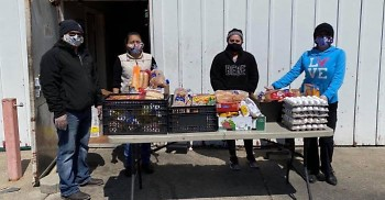 Grand Rapids Area Mutual Aid Network (GRAMAN) team distributing food to local families in need.