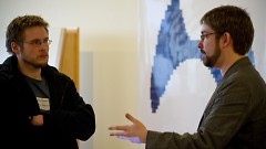 Charles Nutter (right) speaks with Drew Colthorp at SoftwareGR