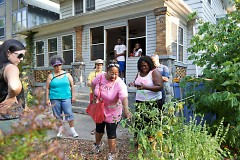 OKT's Lisa Oliver King, touring a yard garden in the Baxter Neighborhood
