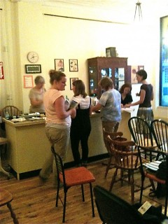 Community members gather in store for a free naturopathy workshop.