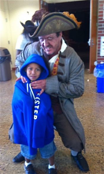 """""""Captain Bill"""" poses with a student"""