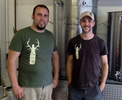 Eric Karns, left, head brewer and owner, and Beau Debruyny, right, assistant brewer of Elk Brewing