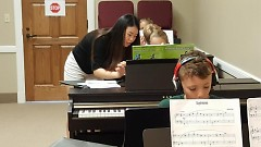 Kids practicing at Stella Royce Piano Camp