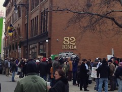 Protesters gather in front of 82 Ionia Ave.