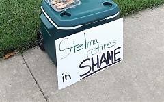 "A sign reads ""Stelma retires in shame"" outside of Noto's on Friday night where the Sheriff's retirement party was held."