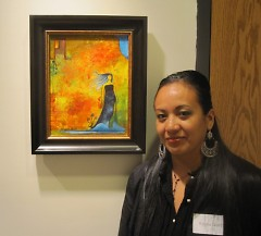 Artist Reyna Garcia with one of her paintings