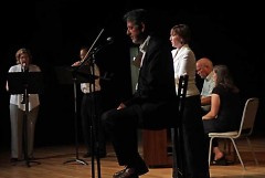 """Rob Cole onstage narrating the premiere of his poetry/musical collaboration 'Something About Autumn"""""""