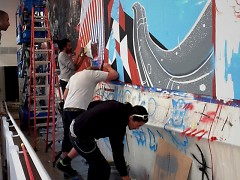 The Screwed Arts Collective at work. Shown, from left to right, Stan Chisholm, Jason Spencer and Justin Tolentino.