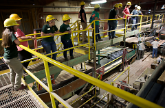 West Michigan instructor Avril Wiers and a group of about 15 others learned about the lumber industry.
